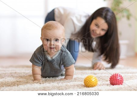 Funny crawling baby infant boy with mother