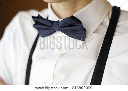 Close-up of a bow tie on the groom. Morning, pre-wedding gatherings, cooking.