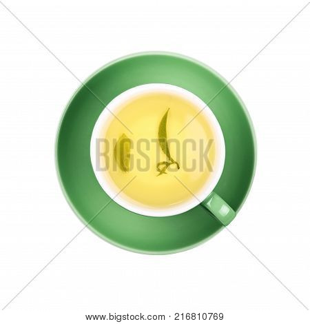 Full cup of clear green tea with floating leaves on green saucer isolated on white background close up elevated top view
