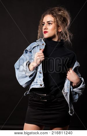 Beautiful young woman in studio photo in model test type of photo session