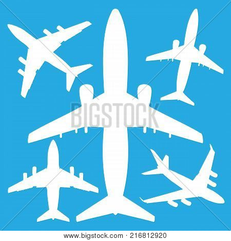 white jet airliners in the air isolated on blue background