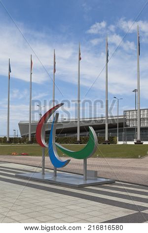 Adler, Krasnodar region, Russia - July 8, 2016: Emblem of the Paralympic Games on a background Tennis Academy in Sochi Olympic Park