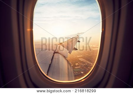 View from the window of the airplane at the sunrise. Landing in Bangkok Thailand.