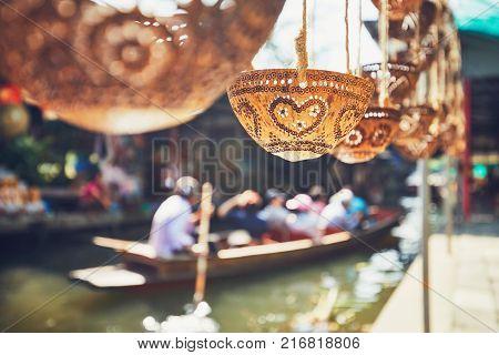 Carved coconut shells on the traditional floating market Damnoen Saduak in Ratchaburi Province near Bangkok Thailand.