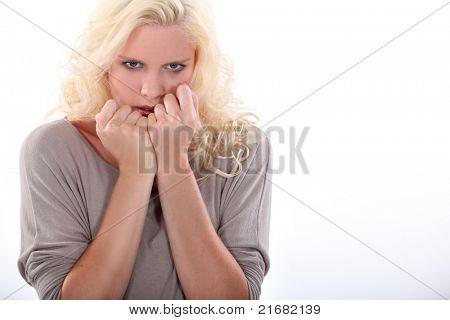 Nervous blond woman