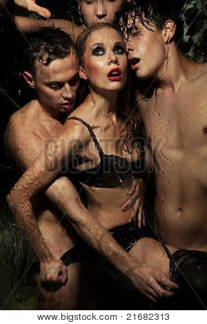 Sexy woman with men