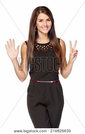 Hand counting seven fingers. Happy woman indicating the number seven with her fingers