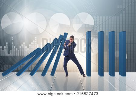 Businessman in domino effect business concept