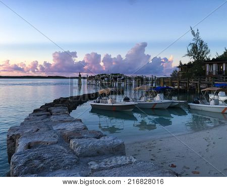 Boat at sunset in Exuma, Bahamas.