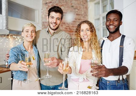 Two happy couples toasting with champagne and wishing you merry xmas