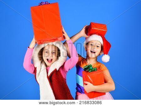 Girls Celebrate New Year. Kids In Santa Claus Hat