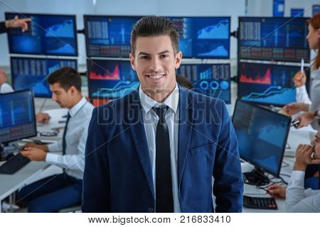 Male stock trader working in office