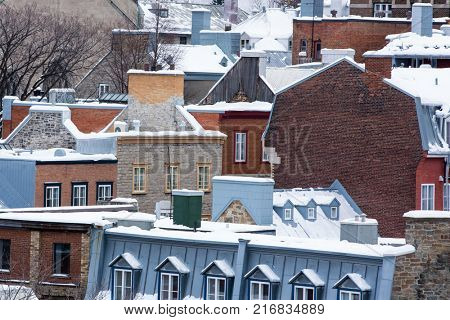 Quebec city rooftops, winter cityscape with snow, in Quebec Province, Canada.