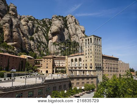 Montserrat Spain - August 8 2016: Montserrat mountains and Benedictine monastery of Santa Maria de Montserrat Montserrat Spain August 8 2016