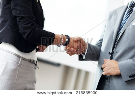 Picture showing business people shaking hands