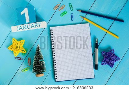 January 1st. Day 1 of january month, calendar on teacher workplace background. Winter time. Empty space for text.