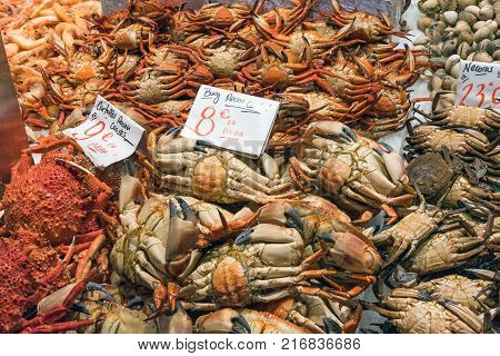 Crabs and other crustaceans for sale at a market in Madrid, Spain