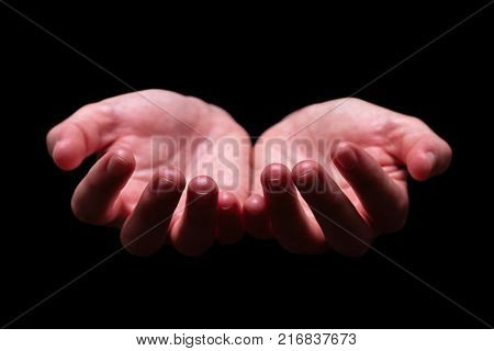 Woman hands cupped in a holding, begging, offering, giving, receiving, protecting gesture. Also for praying, prayer, hold, beg, give, receive, protect, offer concept. Black background, front view