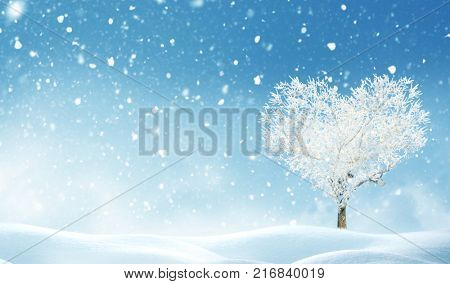 Christmas background with snow Happy new year greeting card with copy-space.Tree of love.Tree of love in winter.Beautiful landscape with heart shaped tree .Love bacground