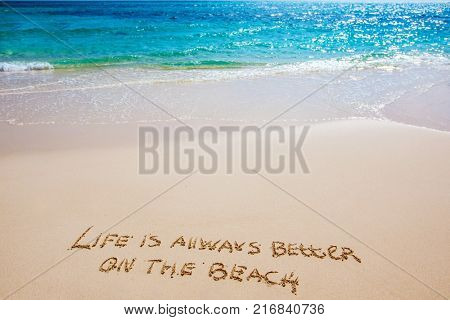 Life is always better on the beach text on white sandy beach and sea