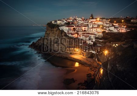 View of beautiful town of Azenhas do Mar in Portugal in the evening