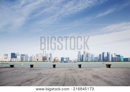empty concrete floor and cityscape of hangzhou qianjiang new city in blue cloud sky