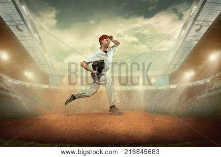 Baseball players in dynamic action on the stadium. Game under open sky.