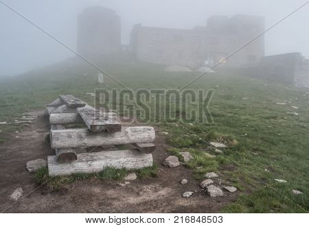 Mist landscape with old abandoned observatory on mount Pip Ivan in Carpathian mountains