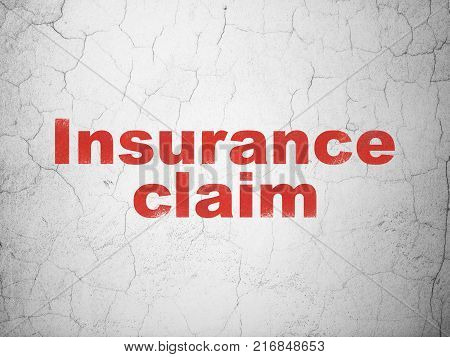 Insurance concept: Red Insurance Claim on textured concrete wall background