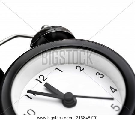Macrophotography Of Black Alarm Clock. Isolated On White. Time Concept.