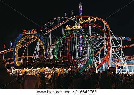 LONDON, UK - NOVEMBER 18, 2017: The Munich Looping Roller coaster ride at Winter Wonderland, annual Christmas Fair in London, UK. The Munich Looping is the world's largest transportable roller coaster