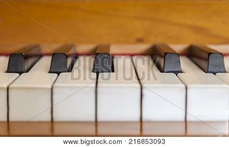 Close-up with very low depth of field of piano keys.