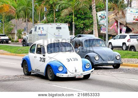 Acapulco Mexico - May 30 2017: Motor cars Volkswagen Beetle in the city street.