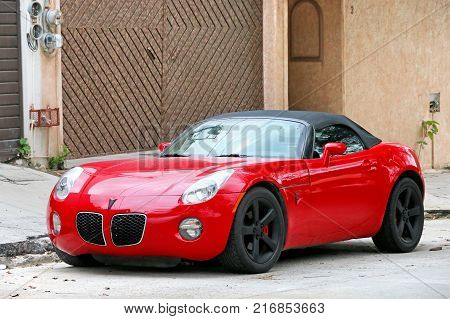 Acapulco Mexico - May 30 2017: Sports car Pontiac Solstice in the city street.