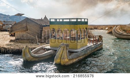 Titicaca Peru - September 2017: Traditional reed boat as transportation for tourists Islas es los Uros Lake Titicaca Peru