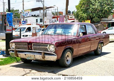 Acapulco Mexico - May 31 2017: Motor car Plymouth Valiant in the city street.