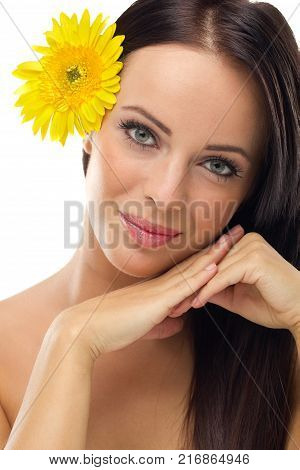 Beautifu youngl woman with yellow flowers in hair