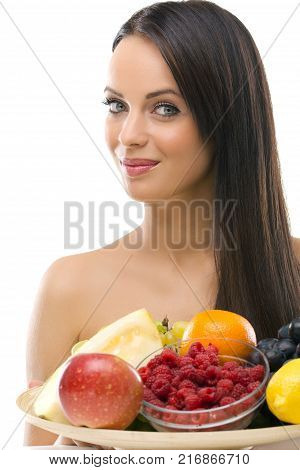 Beautifu youngl woman with fresh fruit   looking at the camera