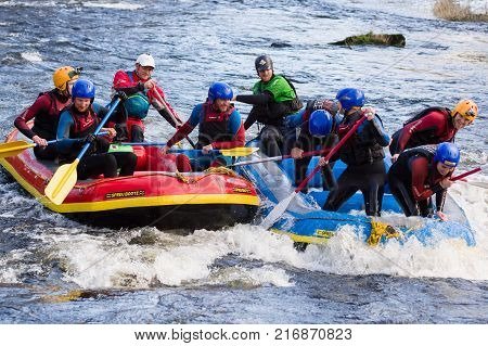 Llangollen Wales UK - January 28 2017: White water rafting a popular team building or group activity on the river Dee or Afon Dyfrdwy in North Wales
