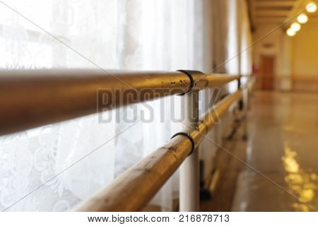 Choreographic machine or barre against the background of the dance ballet class.The handrail in the dance Studio. Interior of an empty dance hall