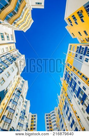 New beautiful and modern complex of buildings. The buildings look alike. The facade is made in three colors.