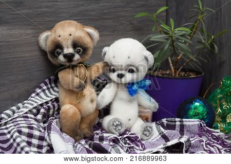 Two felted baby bears on christmas background
