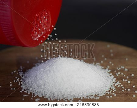 salt granules on wood with red salt