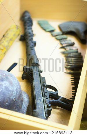 The rusty raked helmet and machine-gun tape at box
