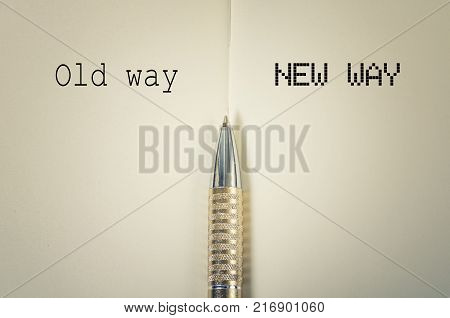 Old way and new way concept with golden pen
