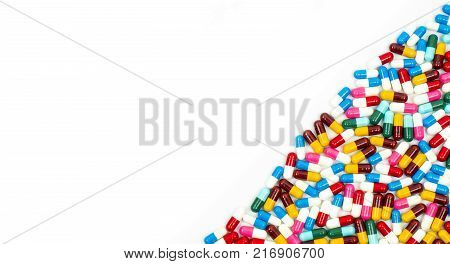 Colorful of antibiotic capsules pills isolated on white background with copy space. Drug resistance concept. Antibiotics drug use with reasonable and global healthcare concept.