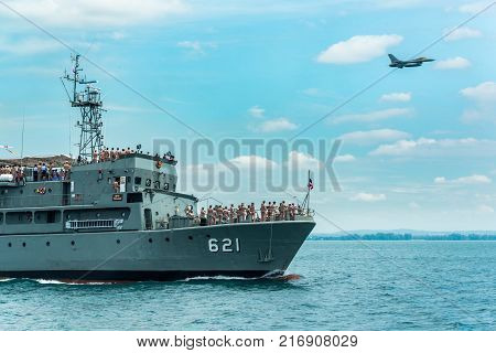 Pattaya Thailand - November 9 2017 Navy warships running on sea while warplane flying above warships on the 50th anniversary ASEAN international fleet review drill in Pattaya Thailand