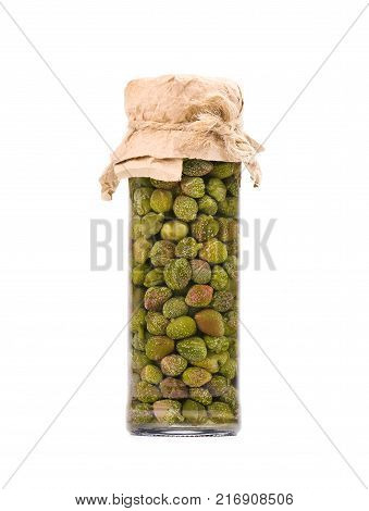 Pickled caper berries in jar isolated on white background. Capers isolated on white background. Pickled capers. Canned capers.