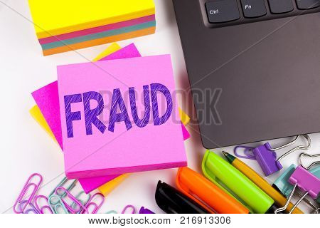 Writing text showing Fraud made in the office with surroundings such as laptop, marker, pen. Business concept for Fraud Crime Business Scam Workshop white background space