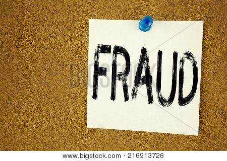 Conceptual hand writing text caption inspiration showing Fraud. Business concept for  Fraud Crime Business Scam written on sticky note, reminder cork background with space